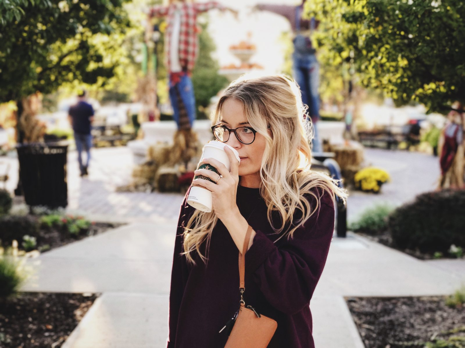 woman drinking starbucks on campus