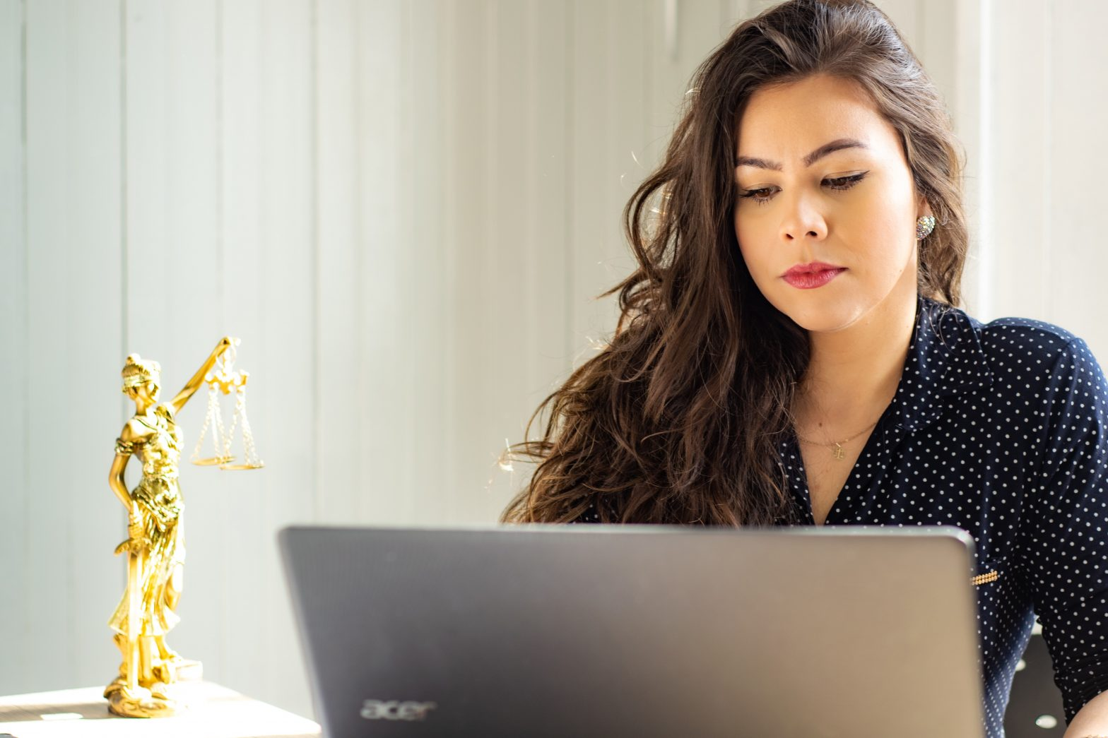 woman working on a laptop from home