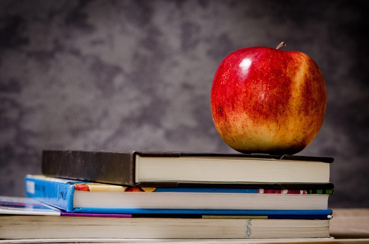 an apple on books