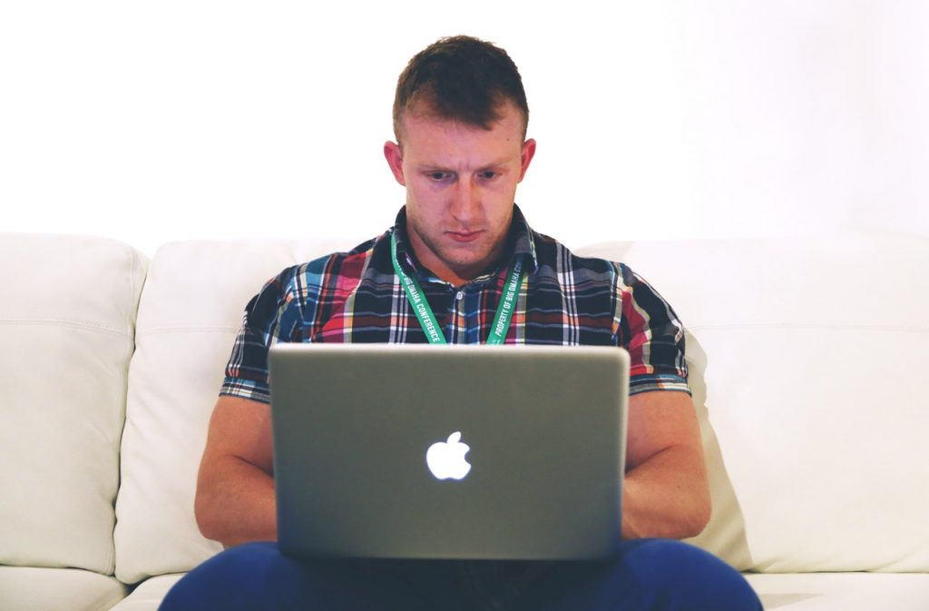 a man looking at a laptop